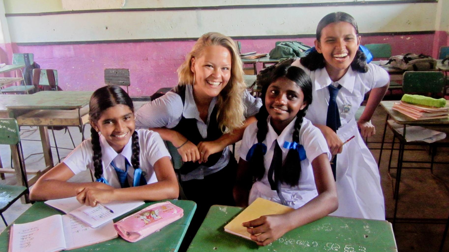Students and a volunteer at her volunteer teaching placement in Sri Lanka